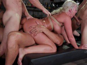 Hot Buxom MILF London River Has Been Dancing Since She Was 18, And Today She Brings One Of Her Personal Fantasies To Bound Gang Bangs. Horny From A Long Day Working The Pole, London Goes Home With A Group Of Customers From Work. She Can't Wait To Get A Taste Of All The Man Meat She's Followed Home, And The Men Can't Wait To Get A Taste Of Her. Clad In Her Work Heels And A Tiny Bikini, She Gets On Her Knees And Immediately Starts Sucking Cock. She Takes Cock After Cock Into Her Wet Mouth, Working Hard To Please The Guys. But The Group Isn't Impressed With Her Cock Sucking Skills And Make Fun Of Her For Being So Bad At Giving Head. Eventually They Tie Her To A Post In The Garage And Take Turns Fucking Her Face. London Takes Every Hard Cock, Gagging On Them As They Hit The Back Of Her Throat. She Squirms As They Play With Her Wet Pussy While They Fuck Her Face. Next, They Suspend Her In Rope Bondage With Her Legs Spread. She Moans As They Begin Fucking Her Warm Wet Cunt. Taking Advantage Of Her Exposed Holes, The Guys Go Straight For Double Stuffing This Eager Strung Up Slut. London Screams As They Fuck Her Pussy And Ass At The Same Time. She Cums Hard As They Pummel Her Holes And Choke Her. London Loves Getting Used Like This And Begs For More. The Guys Take Her Down And Stuff Her Airtight, Fucking Her Cunt, Ass, And Mouth At The Same Time. They Take Turns Spit Roasting Her And Making Her Taste Her Pussy And Ass On Their Cocks. London Screams As They Stretch Her Holes Wide Open. Drool Leaks From Her Mouth As They Ruthlessly Fuck Her Mouth. Finally, They Blow Their Loads All Over Her Face, Leaving London Covered In Cum. Getting Glazed Does Nothing To Dull London's Lust And She Begs To Cum Again. The Guys Grant Her Permission And London Cums Hard. She Loves Being A Used Wrecked Whore. Porn