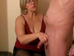 This Girl Next Door Doesn't Like To Show Herself, But She Likes For Her Friend Next Door To Show Himself. While He Is Nude, She Jerks Him Until He Cums Allover Her Dark Stockings. Porn