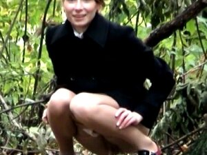 Pretty Amateur Babe Sat On Her Hunkers And Pissed In The Wood. She Was Too Busy With Talking To Somebody Behind The Scenes So Let My Hidden Pee Cam Record Her In Action Porn