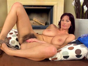 Vanessa J Is Sitting On The Couch Rubbing Down Her Gorgeous Body. She Starts To Strip Until She Is Naked Except For Her Zippered Heels. She Keeps Them On As She Inserts Her Toy Into Her Hairy Pussy. Porn