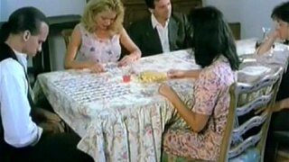 Hairy pussy fingering under the table in this vintage porno video