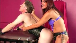 Mistress humiliates and anally trains male slut in chastity device while spanking him