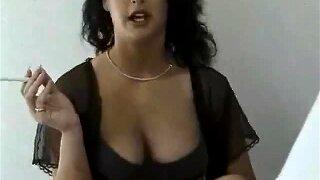 Mature Housewife Enjoys A Smoke While Masturbating