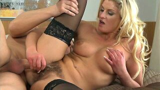 Blonde mom licks a fat cock before taking it in her hairy cunt