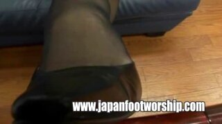 Foot fetish kneading and caressing girl's nylons feet and heel